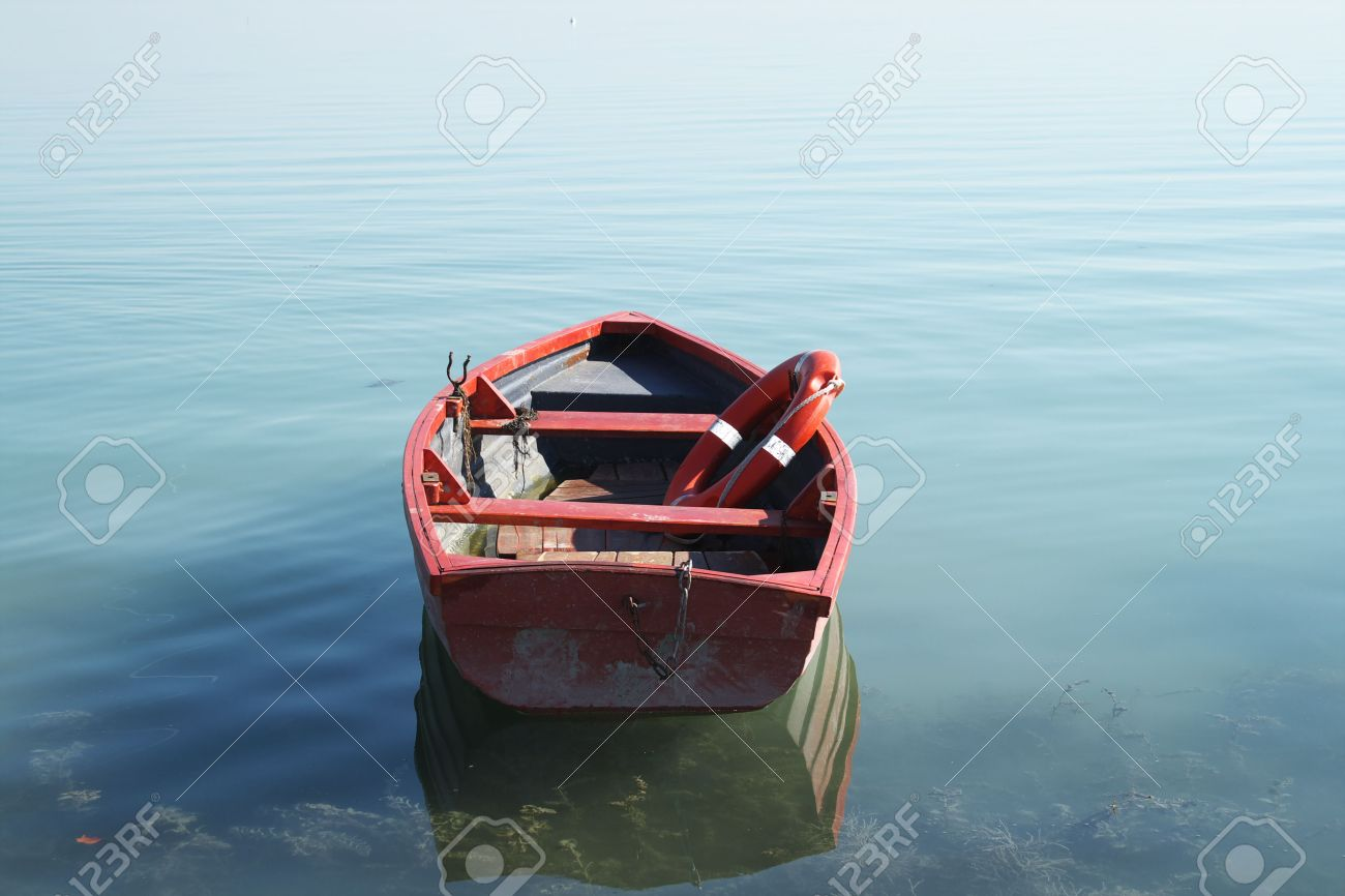 7001751-He-is-a-lifeboat-on-an-empty-beach–Stock-Photo